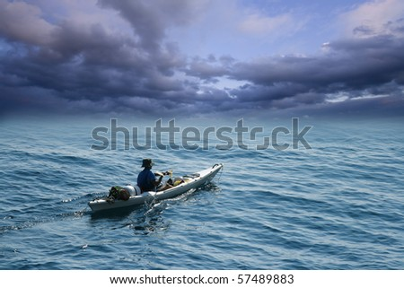 Young man in sea kayak - stock photo