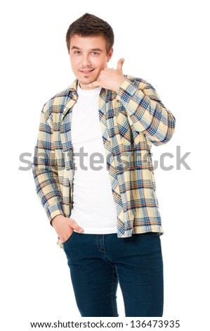 Young man in shirt making a call me gesture, isolated on white background - stock photo