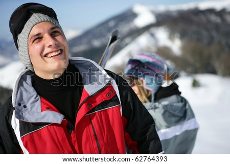 Young man in snowsuit - stock photo