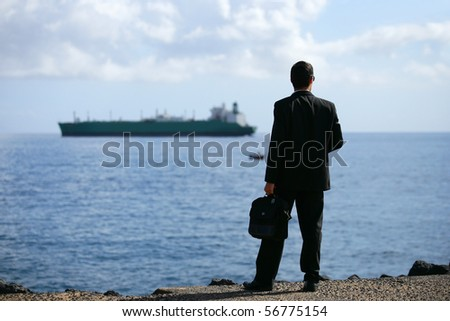 Young man in suit face to the sea - stock photo