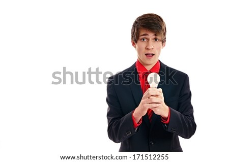 Young man in suit hold at hands a light bulb