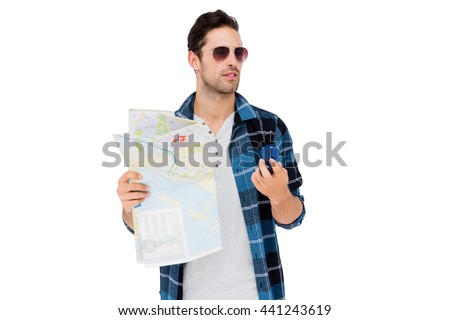 Young man in sunglasses holding a map and compass on white background