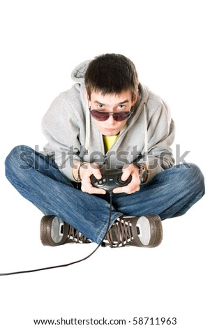 Young man in sunglasses with a joystick for game console - stock photo
