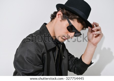 young man in sunglasses with hat  - stock photo