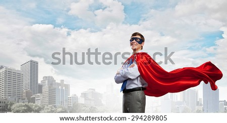 Young man in superhero costume representing creativity concept - stock photo