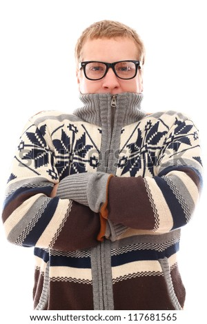 Young man in sweater feel cold over a white background - stock photo