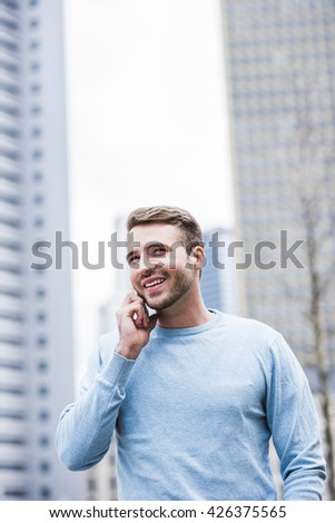 Young man in the city using smart phone