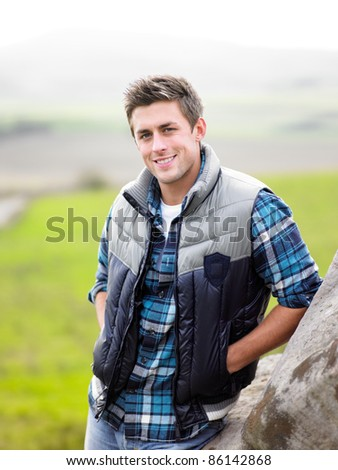 Young man in the country - stock photo