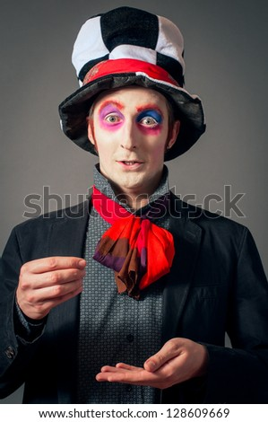 """Young man in the image of the Crazy Hatter from """"Alice's Adventures in Wonderland"""" by Lewis Carroll - stock photo"""