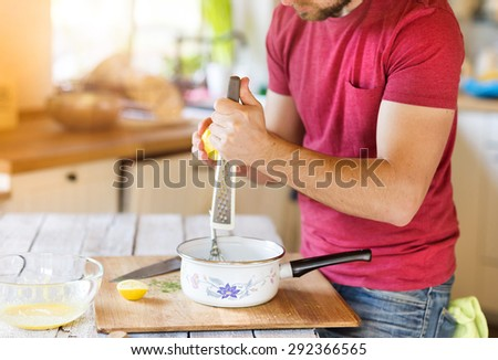 Young man in the kitchen preparing food - stock photo
