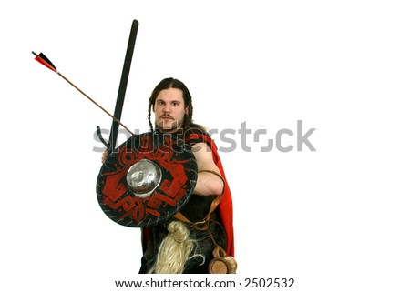 young man in the medieval clothes with a sword - stock photo