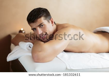 Young man in the spa - stock photo