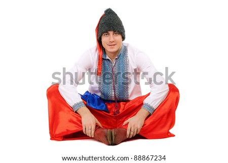 Young man in the Ukrainian national costume. Isolated - stock photo