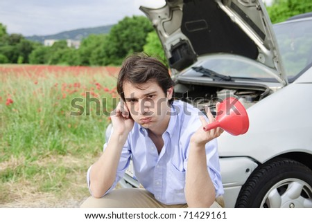 young man in trouble with his car - stock photo