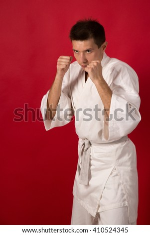 Young man in white kimono training martial art  - stock photo