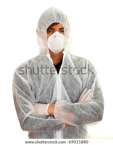 young man in white protective workwear and mask with crossed arms