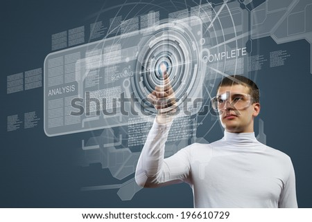 Young man in white touching icon of media screen