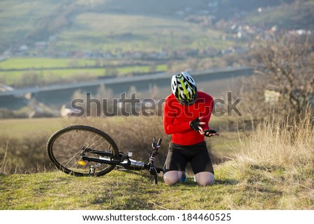 Young man injured during riding a bike - stock photo