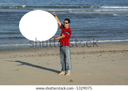 young man insurance a white poster in the beach, where it can write its message... - stock photo