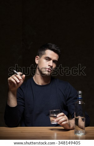 Young man is an alcoholic with problems - stock photo