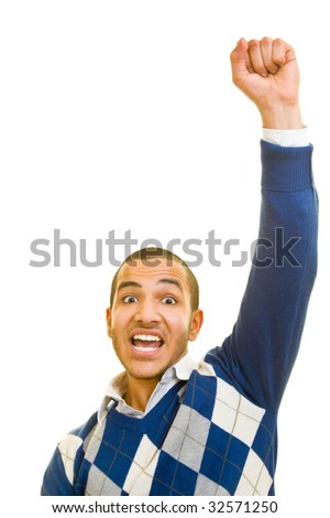 Young man is cheering with his fist in the air - stock photo