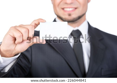 Young man is holding a business card. - stock photo