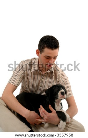 Young man is holding and looking at his sweet dog.