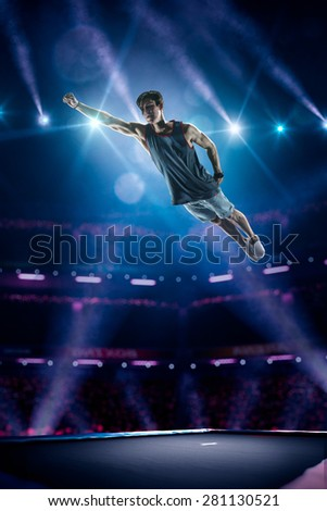 Young man is jumping on the trampoline