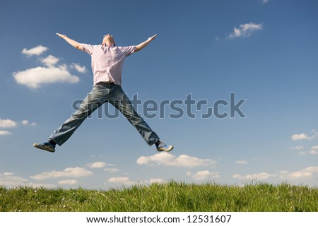 Young man is jumping over a green. Use it for lifestyle concepts