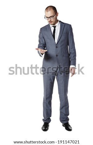 Young man is looking at his empty palm.  - stock photo
