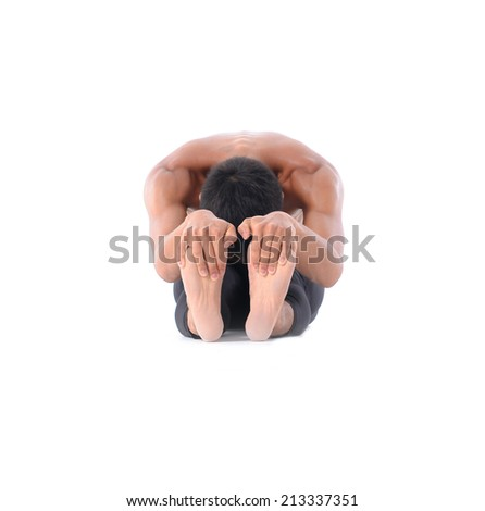 Young man is making yoga isolated over white background - stock photo