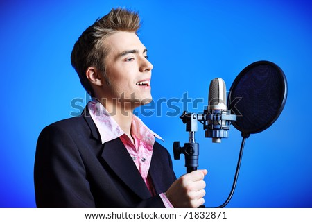 Young man is singing rock'n'roll. - stock photo