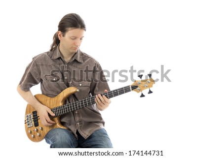 Young man is sitting and playing his bass  (Series with the same model available)
