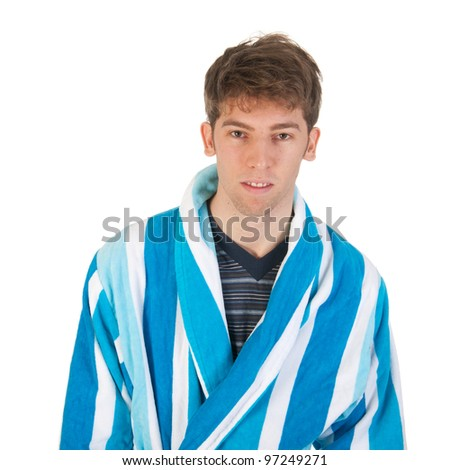 Young man is wearing pajamas and morning gown - stock photo