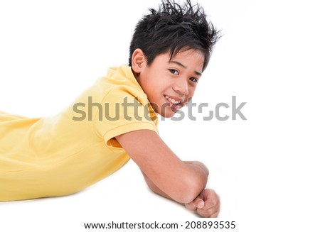 Young man isolated lying on the floor on white background - stock photo