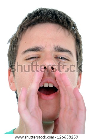 Young man isolated on white background shouting - stock photo