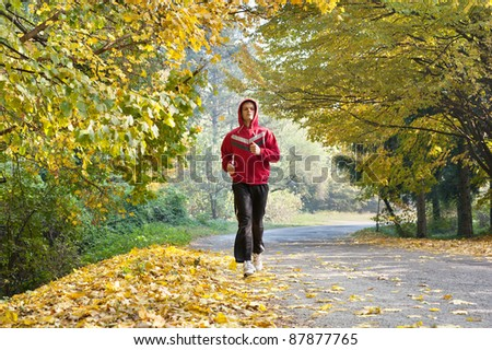 Young man jogging in park - stock photo