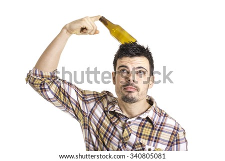 young man joking with a beer bottle - stock photo