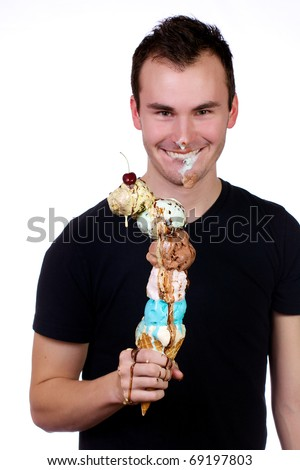stock-photo-young-man-joyously-holds-a-six-scoop-ice-cream-cone-with-ice-cream-all-over-his-face-69197803.jpg