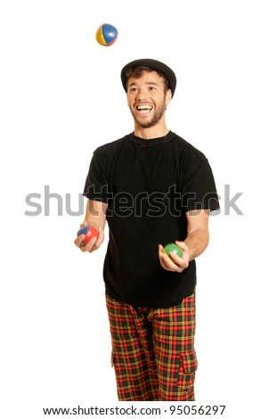 Young man juggling isolated on white background - stock photo