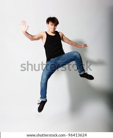 Young man juming in studio - stock photo