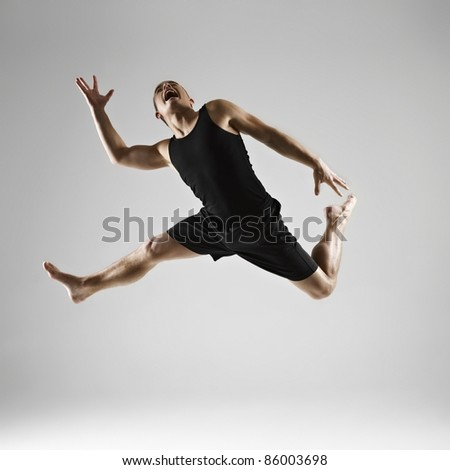Young man jumping - stock photo