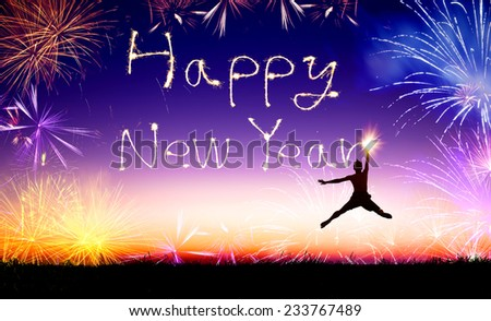 young man jumping and drawing the happy new year - stock photo