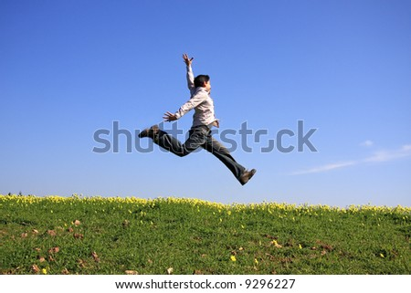 Young man jumping in a beautiful landscape - stock photo