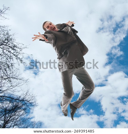 Young man jumping in the air - stock photo