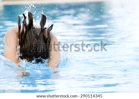 young man jumping in the water - stock photo