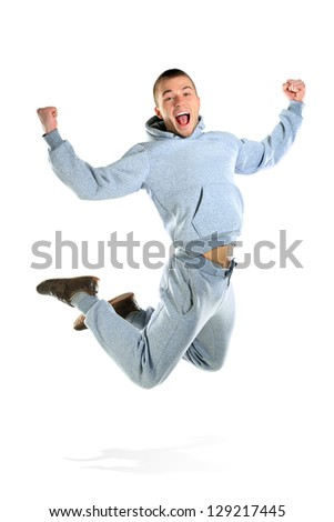 Young man jumping isolated on white - stock photo