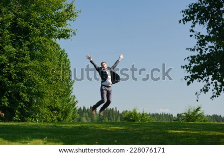 Young man jumping outside - stock photo