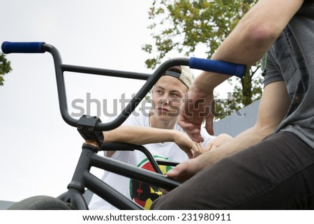 Young man jumping with bikes - stock photo