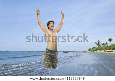 Young man jumping with joy